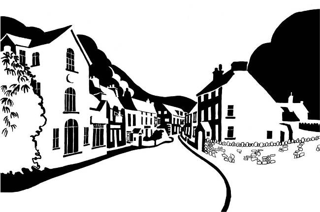 Black and white image of houses between two hills